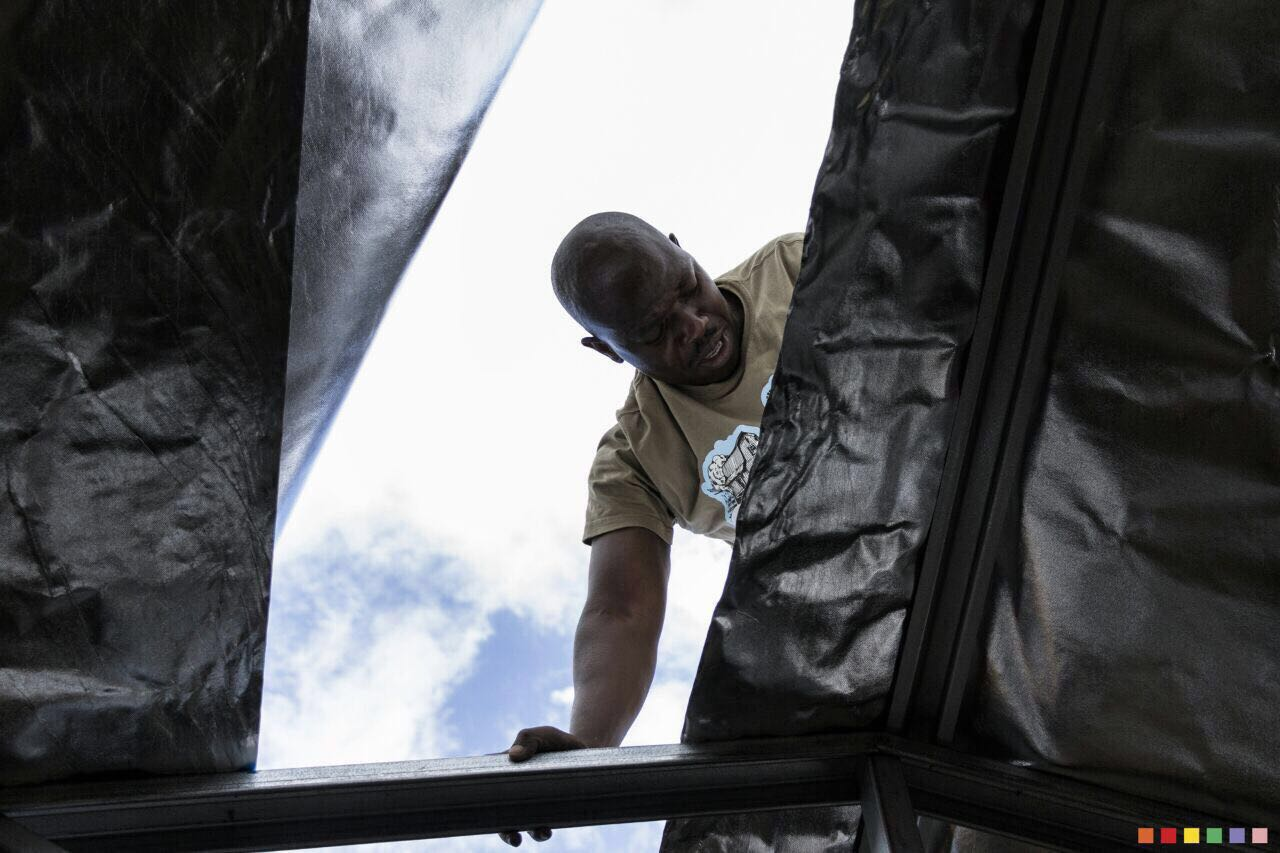 Dezzo Roofing Staff Member Working On An Installation For Child Headed Households